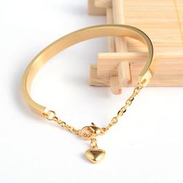 Pulsera acero dorada rigida caña 58x4.8 mm ( grabable). Con corazón