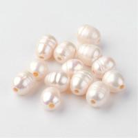 Perla cultivada ovalada blanca 7-10x7-8 mm, taladro 1.8 mm