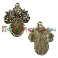 Camafeo bronce con rosas 31x23 mm ( int 14x10 mm)