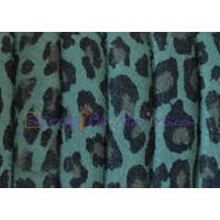 Cuero oval 10x6 mm( regaliz)  serraje leopardo verde (20 cm)