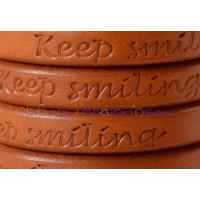 Cuero oval 10x6 mm( regaliz) camel GRABADO KEEP SMILING (20 cm)