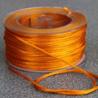 Cordon de saten 1.5 mm, color naranja ( 1 metro)