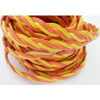 Cordón lato trenzado plano 10 mm. 4 cabos. Amar/rojo (20 cm)