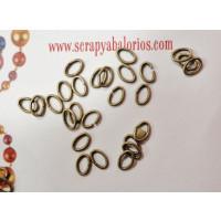 Anilla ovalada 4x6 mm bronce ( 5 gramos, 250 uds aprox)
