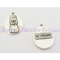 Medalla zamak niña Mi primera comunión 18x14 mm