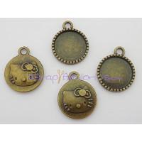 Colgante charm bronce dibujo base camafeo 17 mm. Interior 14 mm