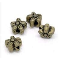 Entrepieza bronce mini flor 6 mm ( 10 uds)