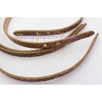 Tira de piel serpiente ocre agujereada 10 mm. 22 cm