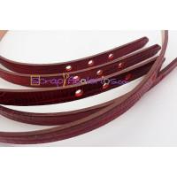 Tira de piel serpiente vino agujereada 10 mm. 22 cm