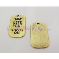 Colgante ZAMAK BRONCE KEEP CALM AND TRAVEL ON 40X25mm