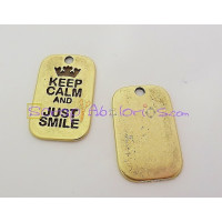 Colgante ZAMAK BRONCE KEEP CALM AND JUST SMILE 40X25mm