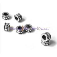 Entrepieza rondel puntitos ZAMAK baño plata 6x4 mm, int 3.3 mm