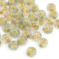 Abalorio redondos abecedario transp dorado glitter con letras doradas 7 mm, int 1.5 mm (250 uds)