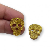 Plexy dorado glitter - Colgante calavera 20 mm, int 1.2 mm