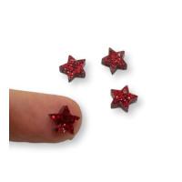 Colgante mini estrella de plexy rojo glitter  7 mm