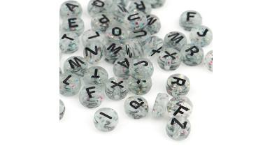 Abalorio redondos abecedario transp plata glitter con letras negras 7 mm, int 1.5 mm (250 uds)